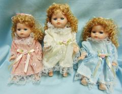 "COLLECTIBLE DOLLS: Set of (3) Collectible 8"" Porcelain Jointed Dolls in Blue, Pink, White dresses"