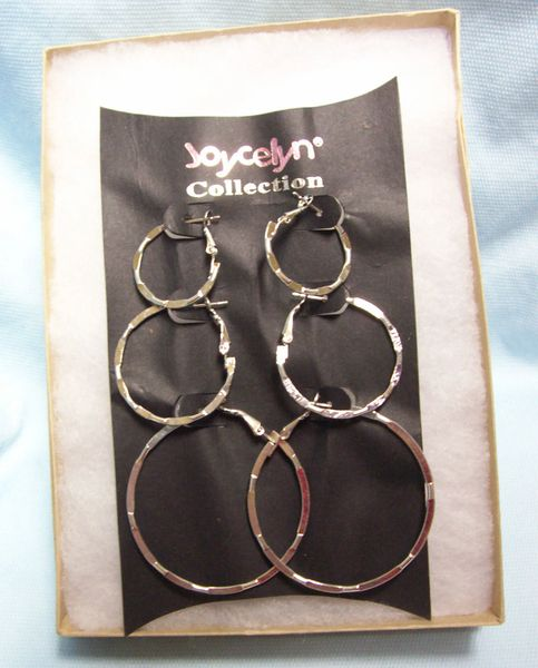 JEWELRY: Trio Set Silver Color Metal Hoop Earrings 3 Different Sizes Latch Back Fastening by Joycelyn Collection