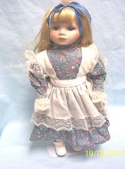 DOLL: Collectible Porcelain Doll with Metal Stand Floral Dress Apron Blonde Hair
