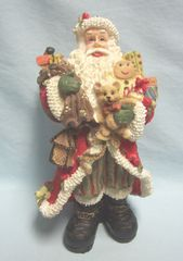"SANTA FIGURINE: Christmas Santa Figurine with His Bag of Christmas Toys Resin Nice Detail 8 1/2"" H"