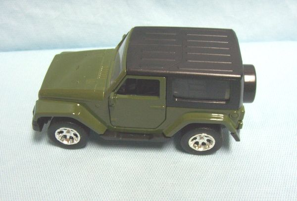 ACTION TOY: Diecast 2014 Jeep Wrangler by Jada 1:32 Pull/Back Action Doors Open