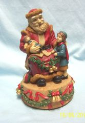 CHRISTMAS DECORATION: Collectible Figurine Musical Santa with Child and Doll Early 1990s