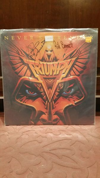 Triumph **NEVER SURRENDER** Signed & Certified LP Cover with vinyl record - GV529199 - signed by: Rik Emmett