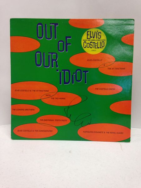Elvis Costello and the Attractions + various artists **OUT OF OUR IDIOT** Signed & Certified LP cover with vinyl record - GV580359 - signed by: Elvis Costello