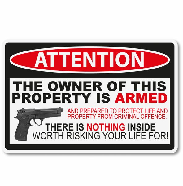 THE OWNER OF THIS PROPERTY IS ARMED VINYL STICKER