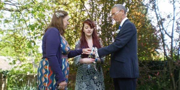 A civil ceremonial handfasting in the Shropshire woods