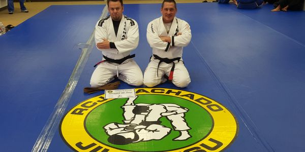 Professor Frank Caracci promoting one of his New Orleans, La. Jiu-Jitsu students to Black Belt