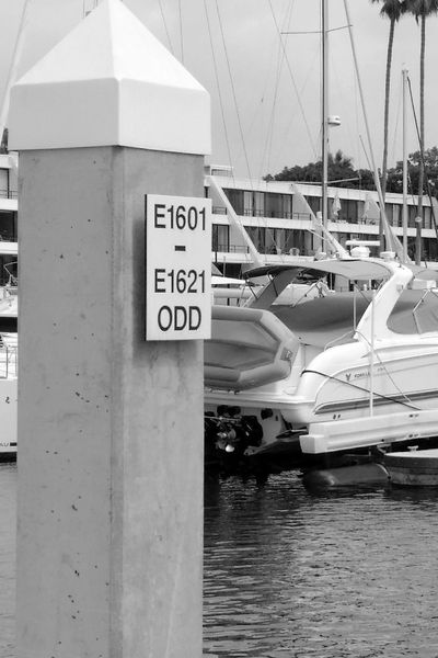 A marina slip number sign can show a range of slip numbers.