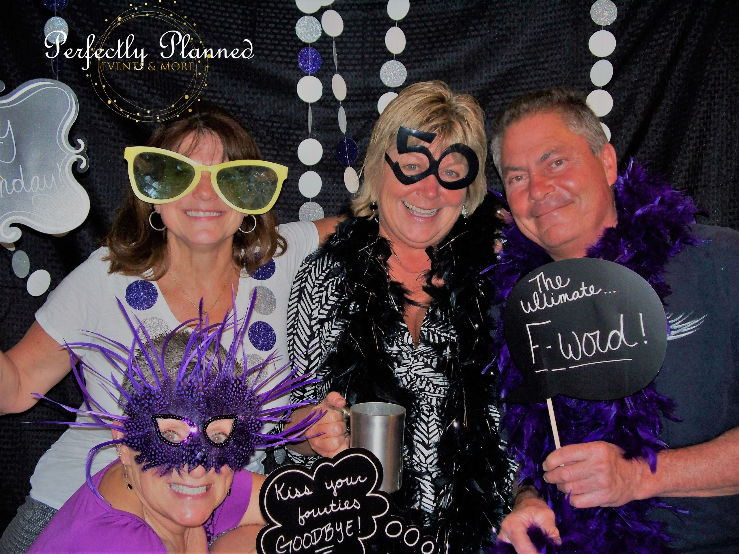 Surprise 50th birthday party with photo booth! Photo Credit: Perfectly Planned - Events & More