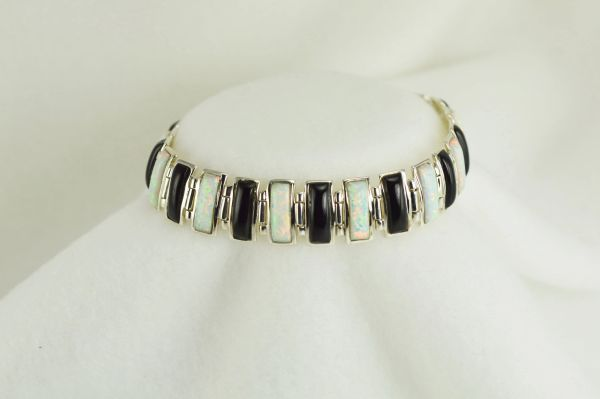 "Sterling silver black onyx and white opal inlay rectangle 8"" link bracelet. B024"