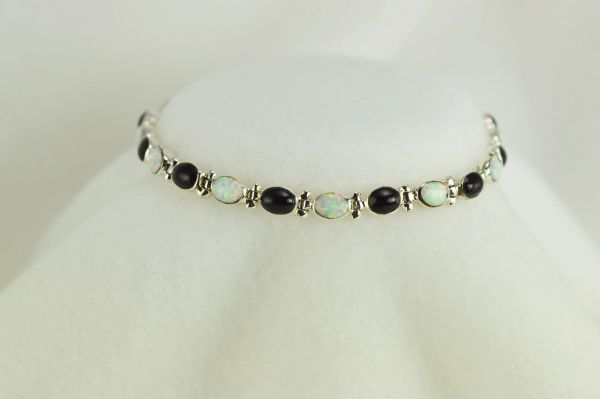 "Sterling silver black onyx and white opal oval 7.5"" link bracelet. B025"