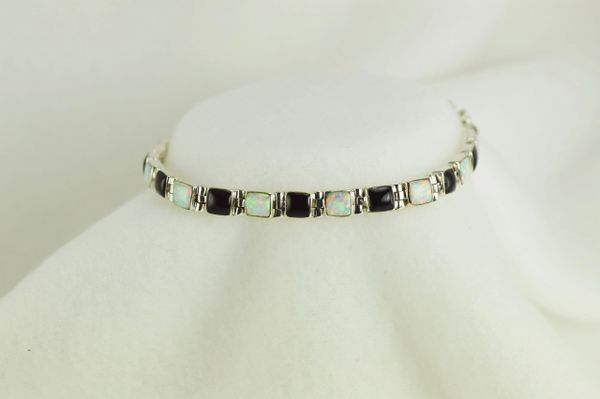"Sterling silver black onyx and white opal square 8"" link bracelet. B027"