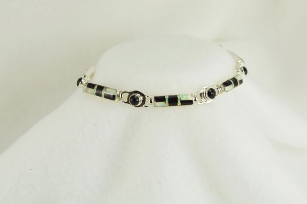 "Sterling silver black onyx and white opal inlay 8"" link bracelet. B028"