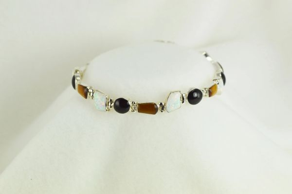 "Sterling silver multi color/multi shape opal, black onyx and tiger eye 8"" bracelet. B030"