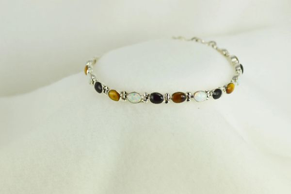"Sterling silver multi color opal, black onyx and tiger eye oval 7.5"" bracelet. B035"