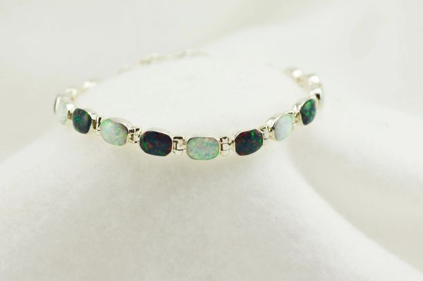 "Sterling silver black and white opal oval link 7.25"" bracelet. B060"