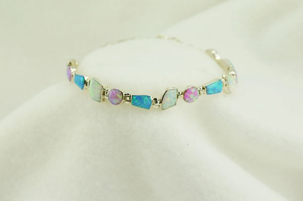 "Sterling silver white, pink and blue opal multi shape stone link 8"" bracelet. B076"