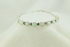 "Sterling silver white opal oval link 7.25"" bracelet. B088"