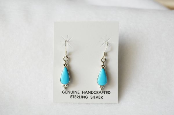 Sterling silver turquoise teardrop dangle earrings. (E052)