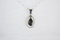 "Sterling silver black onyx inlay teardrop in hoop pendant with sterling silver 18"" box chain. N104."