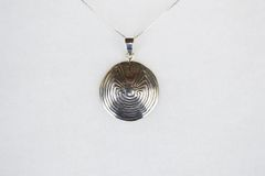 "Sterling silver man in the maze pendant with sterling silver 18"" box chain. N116."