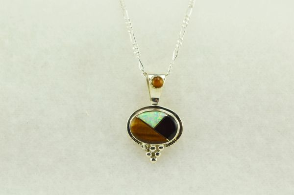 "Sterling silver white opal, black onyx and tiger eye inlay oval pendant with sterling silver 18"" figaro chain. N159"