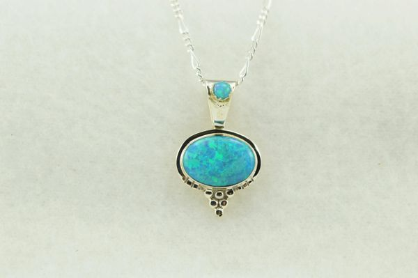 """Sterling silver blue opal oval shaped pendant with sterling silver 18"""" figaro chain. N235"""