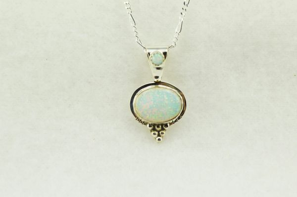 "Sterling silver white opal oval pendant with sterling silver 18"" figaro chain. N238"