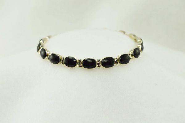 """Sterling silver black onyx oval link 7.25"""" bracelet. B128"""