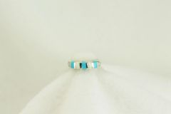 Sterling silver turquoise and white opal inlayl ring. R125