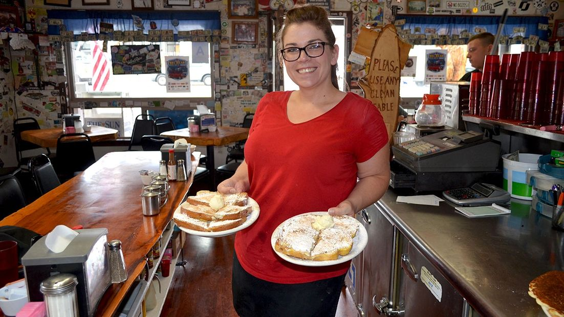 Grizzly Manor Cafe manager, Janelle Scherer serving french toast in Big Bear Lake