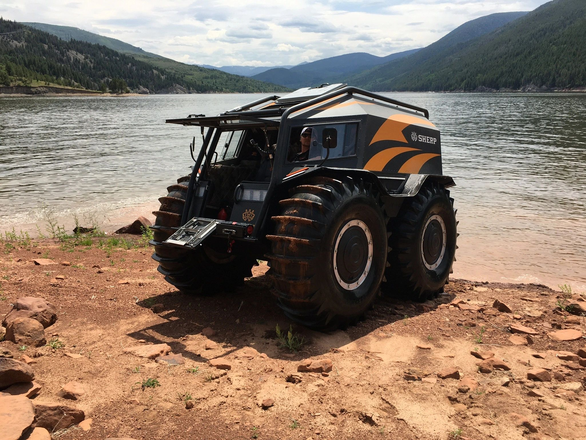 Sherp Pro on shore of lake