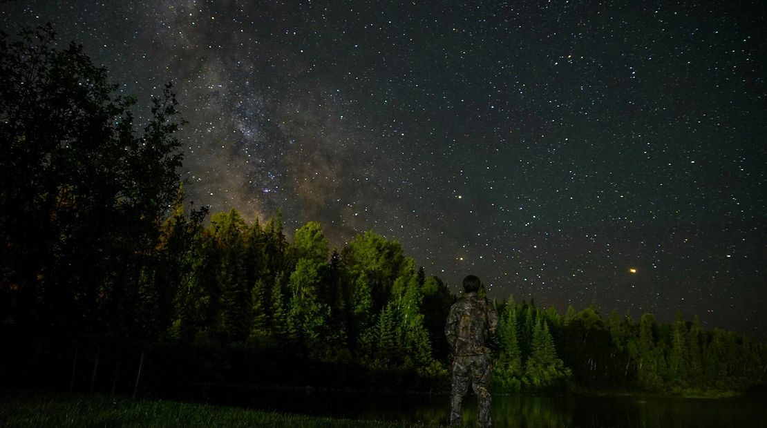 Jake Tucker at Bear Camp in Canada under the stars