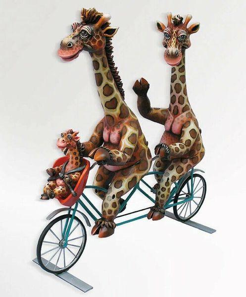 Giraffe Family on Bike