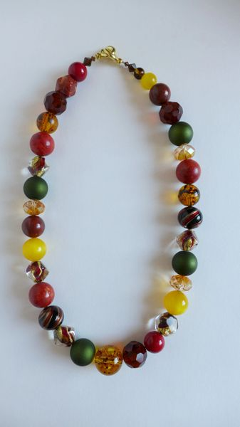 23.5 Inch Single Strand Necklace with Amber, Coral, Swarovski Crystals, Jasper, Czech Glass, and Gold Foil Murano Glass Pebbled Beads