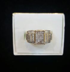 10KT Round. Princess Cut And Baguettes Diamond Ring