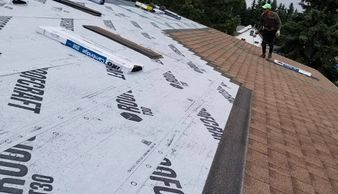 Roofing process by Alberta strong roofing   IKO Cambridge colour earthtone cedar underlayment