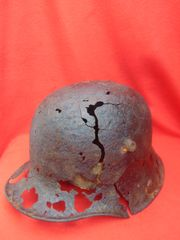 German M16 helmet with blast damage and liner remains recovered from Passchendaele 1917 battlefield