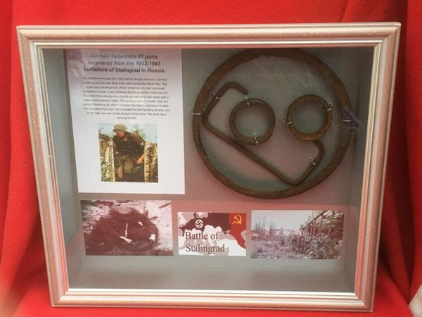 Glass framed group of parts from German Anti Tank Tellermine 42 top plate ring,carry handle,springs recovered from Stalingrad 1942-1943 battlefield in Russia