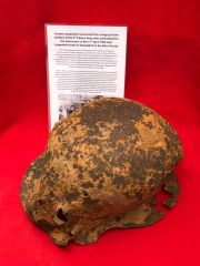 Battle damaged German soldiers M35 helmet recovered from a large pit used by soldiers of the 5th Panzer Army who surrendered to the Americans on the 17th April 1945 near Langenfeld south of Dusseldorf in the Ruhr Pocket