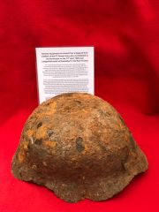 Battle damaged,bent German soldiers M35 helmet recovered from a large pit used by soldiers of the 5th Panzer Army who surrendered to the Americans on the 17th April 1945 near Langenfeld south of Dusseldorf in the Ruhr Pocket