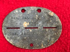 German soldiers complete dog tag stamped company Ersatz Abteilung recovered from the Demyansk Pocket Battlefield south of Leningrad in Russia 1941-1942 battlefield