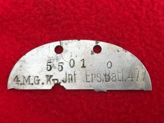 German soldiers half dog tag stamped 4 M.G. company Infantry Ersatz Battalion 477 recovered from the Demyansk Pocket Battlefield south of Leningrad in Russia 1941-1942 battlefield