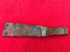 American Browning machine gun ammunition belt starter tab,bent up,brass colour with markings recovered from the Meuse Argonne Forest the 1918 battlefield