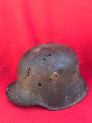 German soldiers M16 helmet with original brown/green paintwork,battle damage crack recovered near St Julien 1915 battlefield then part of 1917 battle of Passehendale