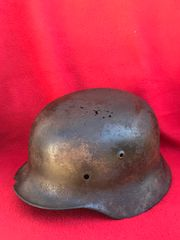 German soldiers M40 helmet with green paintwork remains and decal outline recovered in the Demyansk Pocket south of Leningrad the February- April 1942 battlefield in Russia