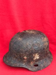 German soldiers M35 helmet with decal,liner remains,battle damage recovered from Plota,near Prokhorovka on the 1943 battlefield at Kursk in Russia