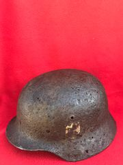 German soldiers double decal M40 helmet with paintwork remains,chin strap recovered from the Reichswald Forest part of the Siegfried Line the battle fought between 8th February to 11th March 1945 in Germany