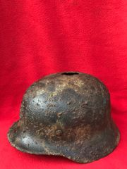 German soldiers M35 helmet fantastic condition relic with most of its original green paintwork,single Army decal,liner ring recovered from Sevastopol the battlefield of 1941-1942 in the Crimea