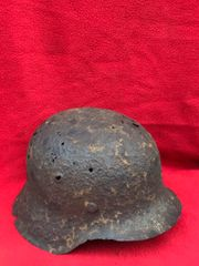 German soldiers M42 helmet with green paint remains,very nicely cleaned relic recovered near the village of plota,south of Prokhorovka the Kursk battlefield July 1943 Russia